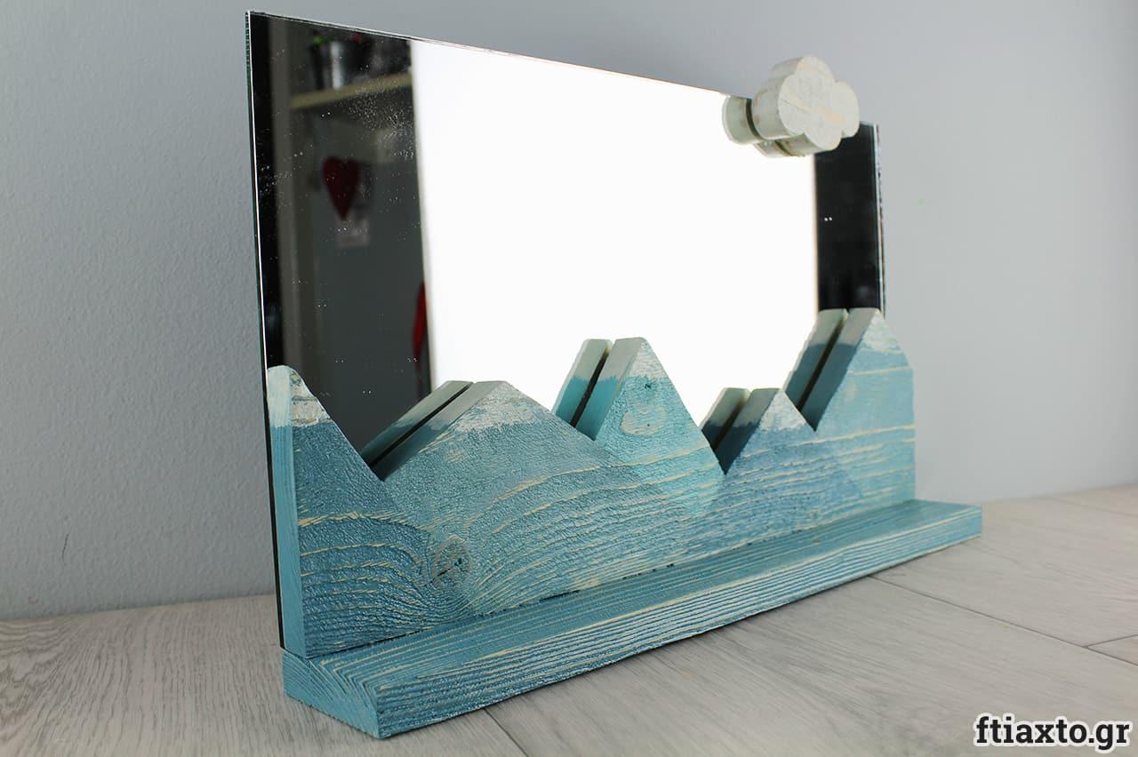 Καθρέπτης και ραφάκι με χιονισμένα βουνά